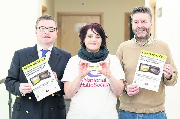 Launching the new Austism Alert Card to help those with austism avoid trouble are, from left, South Swindon MP Robert Buckland, Swindon and District NAS Branch Officer Oriana Morrison-Clarke and Dash manager Adrian Embling
