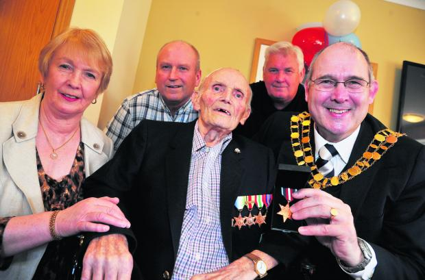 Ivor Frost is awarded the Artic Star Medal at Orchid Care Home. Pictured, left to right, Diane White, daughter, Roger Frost, son, Ivor Frost, Michael Frost, son, and Swindon Mayor Nick Martin