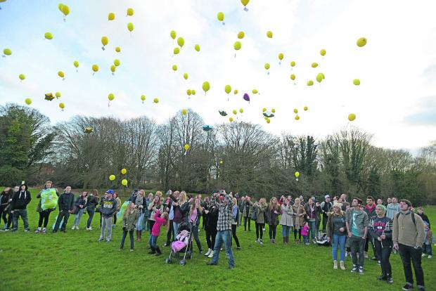 Family and friends of Ashley McKinnon released yellow balloons in his memory in Moredon