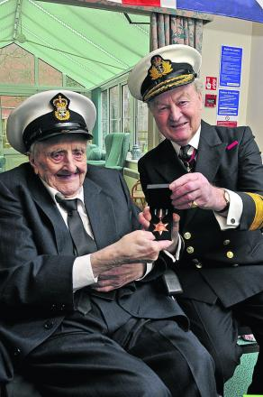 Reginald Smart being awarded the Arctic Star by Rear-Admiral Nick Wilkinson