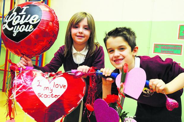 Two Covingham Park school pupils with their decorated bikes. Picture: THOMAS KELSEY