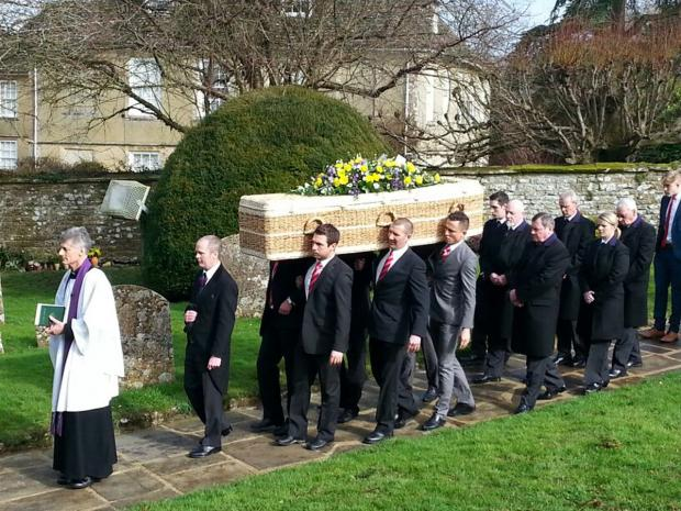 Pallbearers carry the coffin of Dave Turner into Wroughton Parish Church