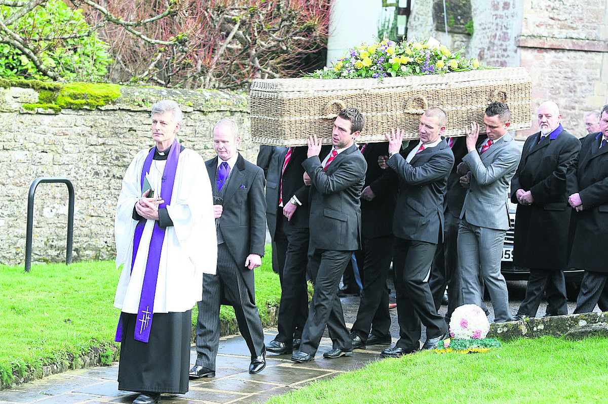 Pallbearers carry the coffin of Dave Turner at Wroughton Parish Church yesterday