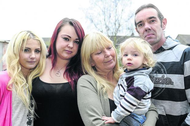 Chris Scott's family, from left, girlfriend, Rebecca Ball, sister Danielle Scott, mother Wendy Scott,  son Logan Scott and father Mike Scott