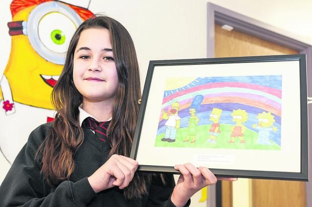 Megan Parmenter with the picture she painted for the Great Western Hospital A&E department. Pictures: ALEX SKENNERTON