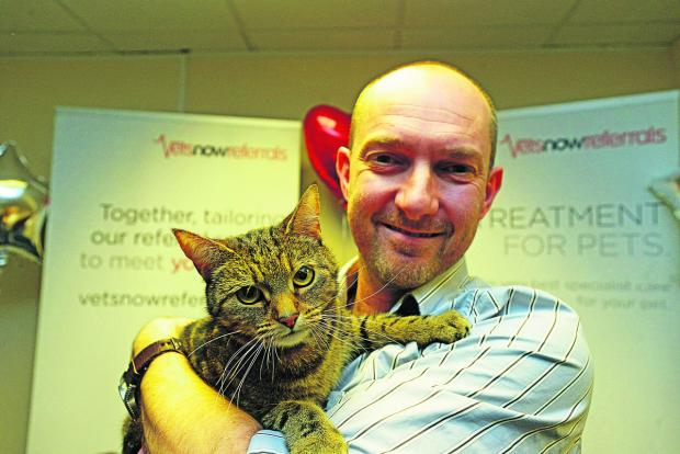 Neil Smith with Jasper the cat, the overall winner of the brave pets awards at Vets Now Referrals