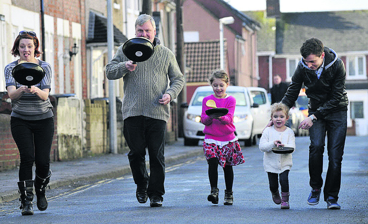 Rev Harvey Gibbons, second right, says pancake races at St Augustine's Church, Rodbourne, are part of new plans to boost the congregation