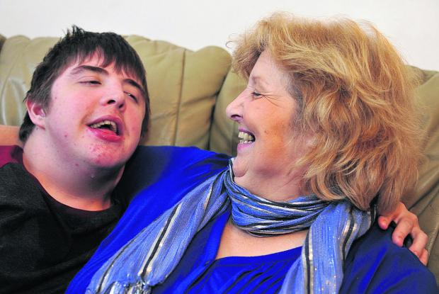 Teresa Brett with her 18-year-old son Robin, who has learning difficulties. Teresa set up the Swindon Children Without A Diagnosis charity
