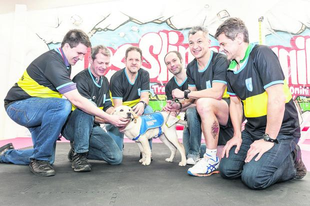 Swindon Advertiser: Les Slinn and his All Star team meeting the guide dog they helped to raise the money to buy for the first time. From left, Rob Sainsbury, Ady Mould, Liam Guest, Froome the puppy, Andy Willis, Les Slinn, Wayne Purkins
