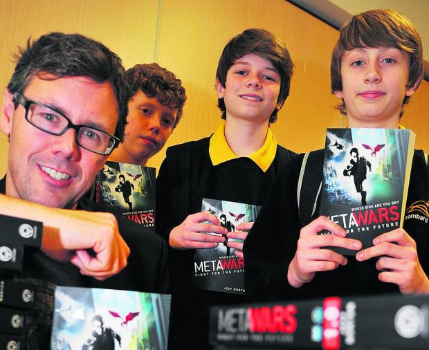 Teen author proves a hit with pupils