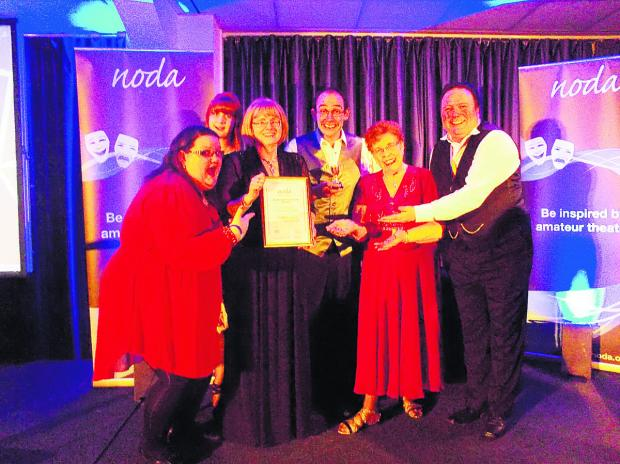 Wootton Bassett Light Operatic Society receiving the South West District Achievement Award for Alice In Pantoland.  From left, assistant director Megan Crocker, writer Elle Smart, director Ros Vickers, chairman Mike Davies, president Sheila Dunn and vice-