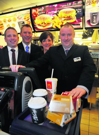 David Boote got a job at McDonalds through SEQOL. He has now earned his four employee star from the company. Pictured, left to right, are Neil Laybourne, manager, Paul Booth, franchisee, Ann King, SEQOL, and David