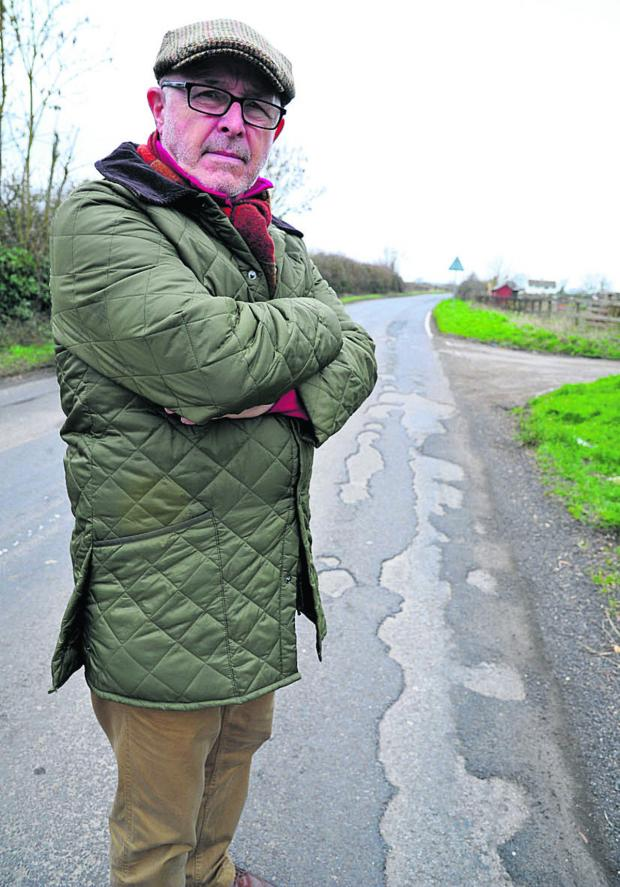 Swindon Advertiser: Resident Mike Eldridge is unhappy about work to fill in potholes