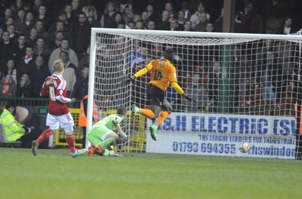 Wolves' Bakary Sako scores his side's third goal against Swindon Town last night
