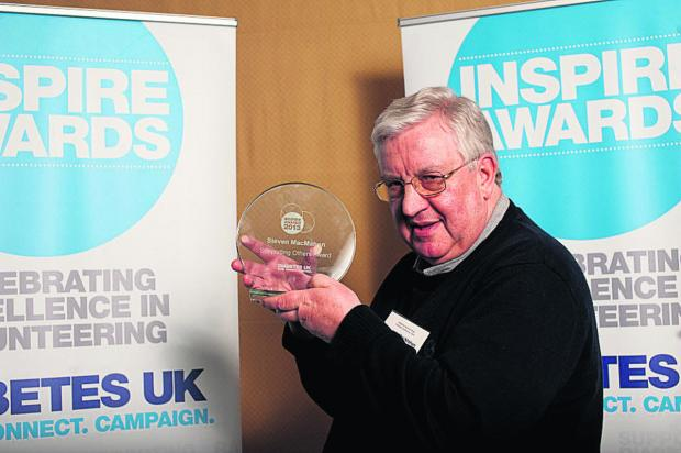Stephen MacMahon with his award