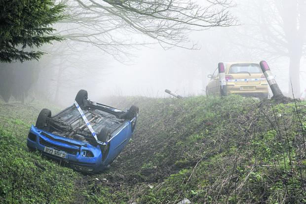 A Fiat Punto overturned on Brimble Hill, Wroughton, after the driver swerved to avoid a deer. Picture: ALEX SKENNERTON