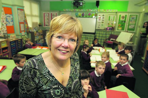 Headteacher Jan Thomas pictured with pupils