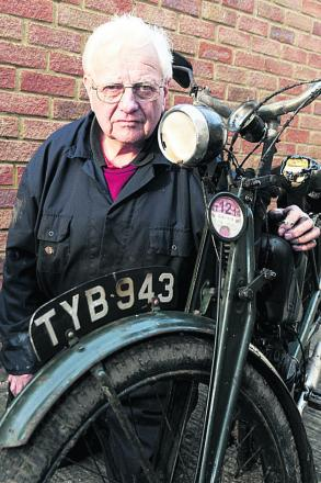 Dennis Iles with one of his burnt out bikes