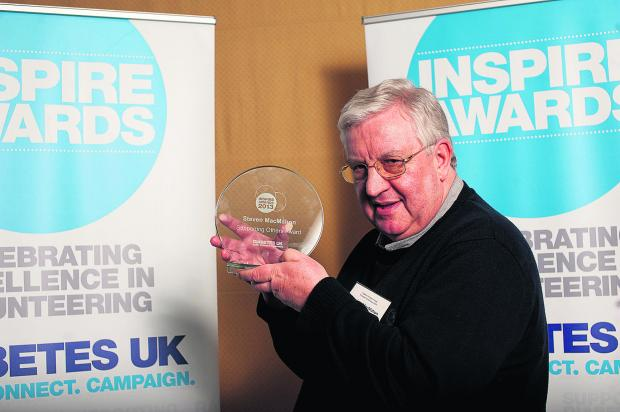 Stephen MacMahon, who campaigns for better a diabetes service in the town, pictured with the Inspire Award from Diabetes UK