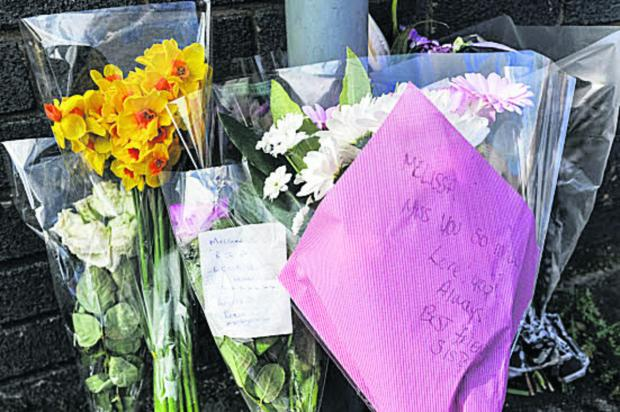 Flowers at the scene of Melissa Castle's death