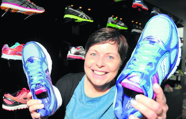 Non-Hodgkins lymphoma survivor Tracy Dixon, who owns the Run shop in Wood Street, is running the London Marathon in April