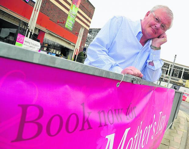 Paul Notton, owner of Rudi's Bar, with the banner advertising Mother's Day. Picture: DAVE COX