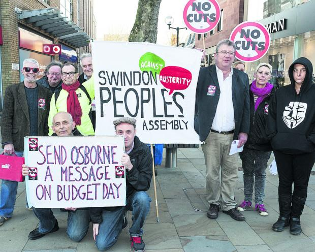 Swindon Advertiser: Protesters make their views known in Swindon town centre yesterday