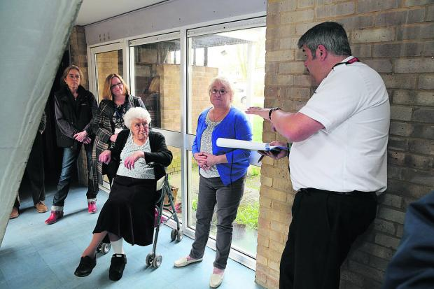 Doris Turner, centre, and other residents during a meeting at their homes in Pound Close with GreenSquare representatives. Picture: STUART HARRISON