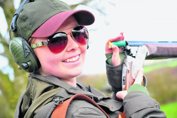 Amelia Garrett loads up at the charity clay pigeon shooting competition at Barbury Shooting School