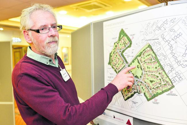 Graeme Towle, from TSH Architects  showing residents of South Marston the plans for redevelopment of Crown Timber and Thornhill Industrial Estates to provide 150 new homes