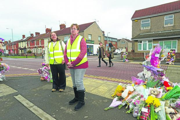 Sarah Evans, head of Moredon speedwatch, left,  with Thirza Noden at the site of the fatal accident