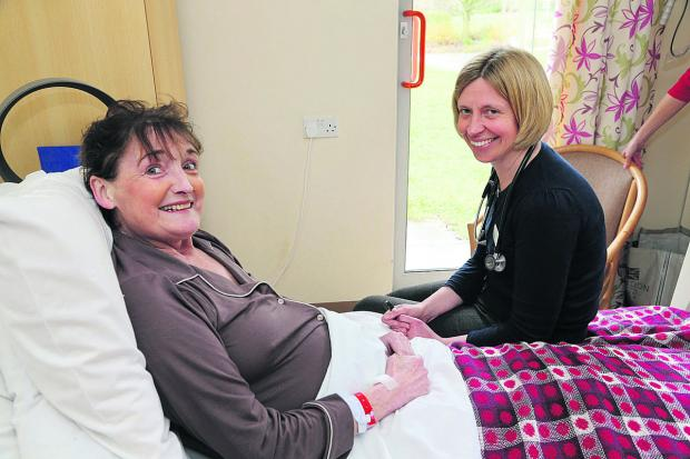 Prospect Hospice's  Dr Kate Tredgett tends to patient Irene Fisher