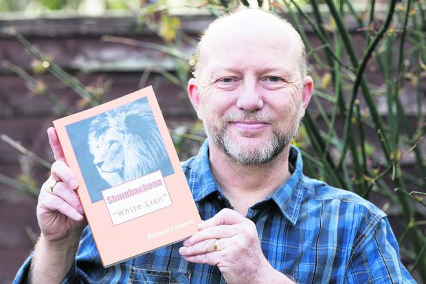 Nicholas Stanton with his book Shumbachena White Lion, which is about poaching in Zimbabwe