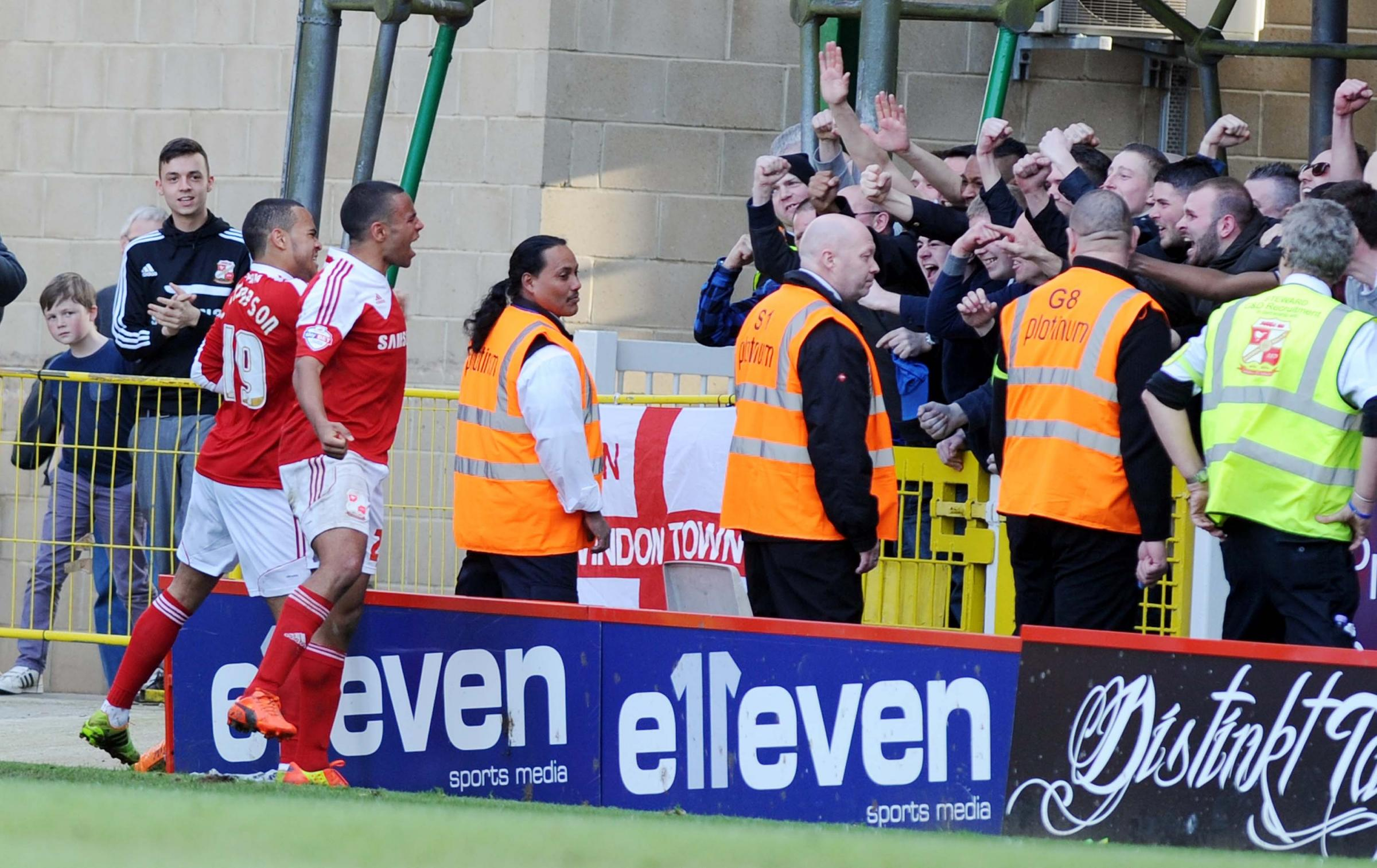 Louis and Nathan Thompson celebrate Town's last minute winner