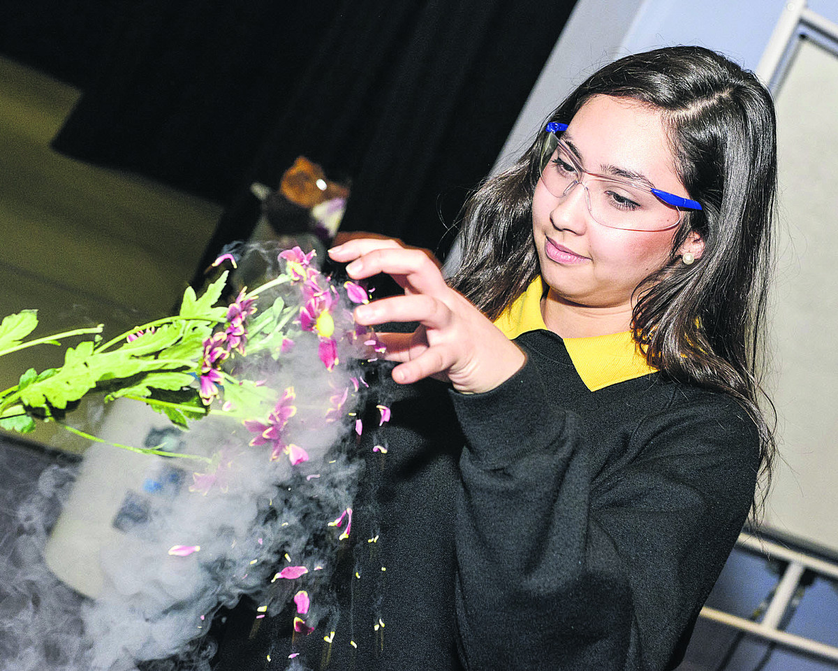 Maria Schoeps, from Isambard School, witnesses the effect of liquid nitrogen on a flower