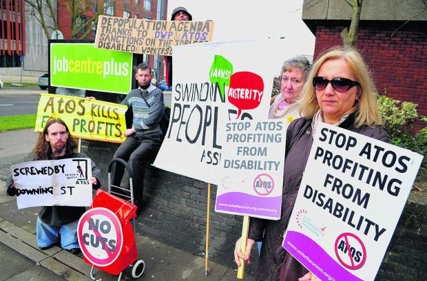 Demonstrators at the Jobcentre urge the government not to agree any more contracts with Atos