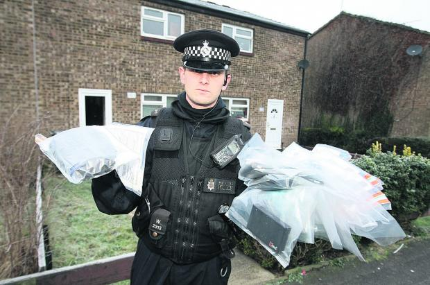 PC Tom Turner on a drugs bust in Toothill last year