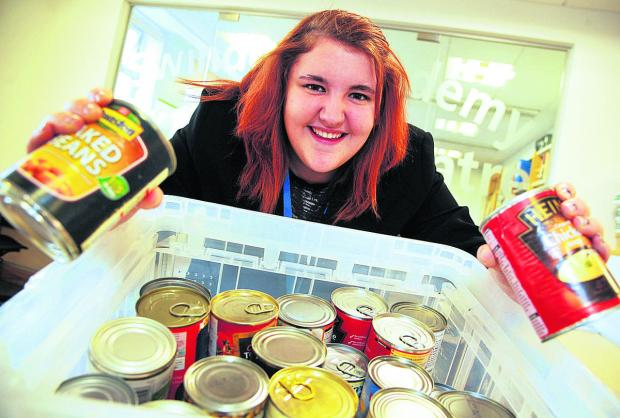 Kayleigh Shelton, from Swindon Academy, has collected boxes of food for Swindon Foodbank