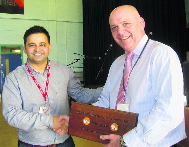 Stand By Me representative Ahmad, who presented a commemorative plaque to Royal Wootton Bassett Academy head teacher George Croxford after the academy raised £15,000 for a school to be built in Burma where 40 per cent of children have no access to educat