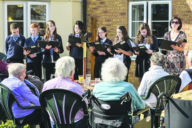 Year 9 Commonweal students singing to residents of Princess Lodge Care Home. Pictured, left to right, are Eddie Corner, Tom Fisher, Sarah Turner, Maddison Sandhu, Holly Snowdon, Georgie Oakwell, Emma Booth and Ali Sutcliffe