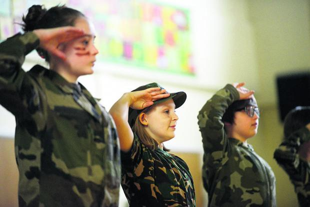 Red Oaks School pupils came to attention as they took on various roles to help  understand the history of the First World War