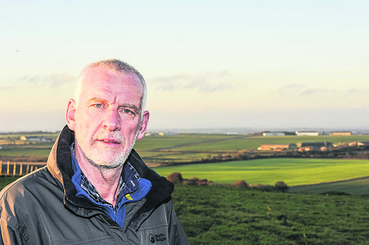 Steve Harcourt who is in favour of the solar farm plans with Wroughton Airfield in the distance