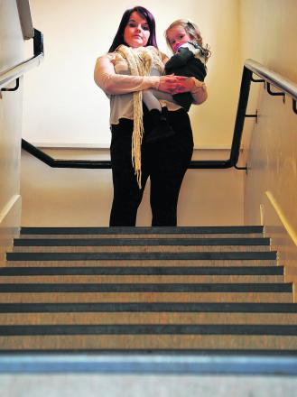 As Finlay Gray's daughter Bronwyn has cerebral palsy she has to be carried up and down the steep stairs in the block of flats where they live