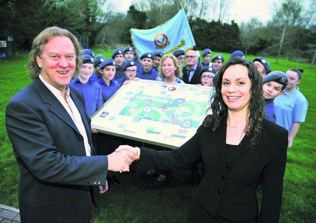 The Royal International Air Tattoo presents 2003 Stratton Squadron with art work after it won a national competiton.  From left, David Bent and  Helen Webb
