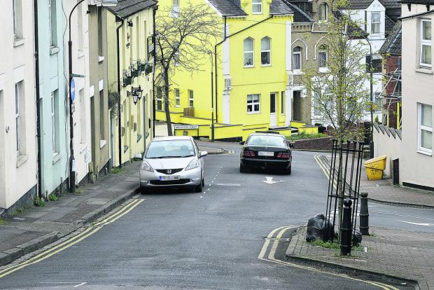 A car going the wrong way down Prospect Hill as a result of the closure of Crombey Steet
