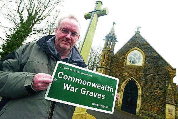Andy Knowles of the Commonwealth War Graves Commission at the cemetery in Kingshill