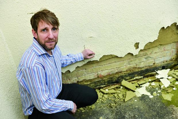 Andy Cuss, director of Artdeans, is one of a group of business owners who have found damage to their buildings due to vibrations caused by the drilling works around the Outlet Centre