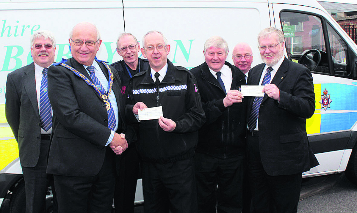 Phillip Bullock, assistant provincial grand master of Wiltshire and Arthur Bierschenk,        worshipful master of the Lodge of Loyalty, Marlborough, presenting a cheque to the trust