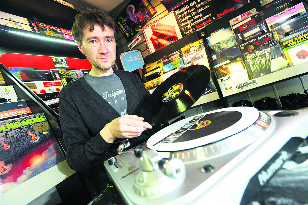 Paul Holmes, of Red House Records, with some of the records
