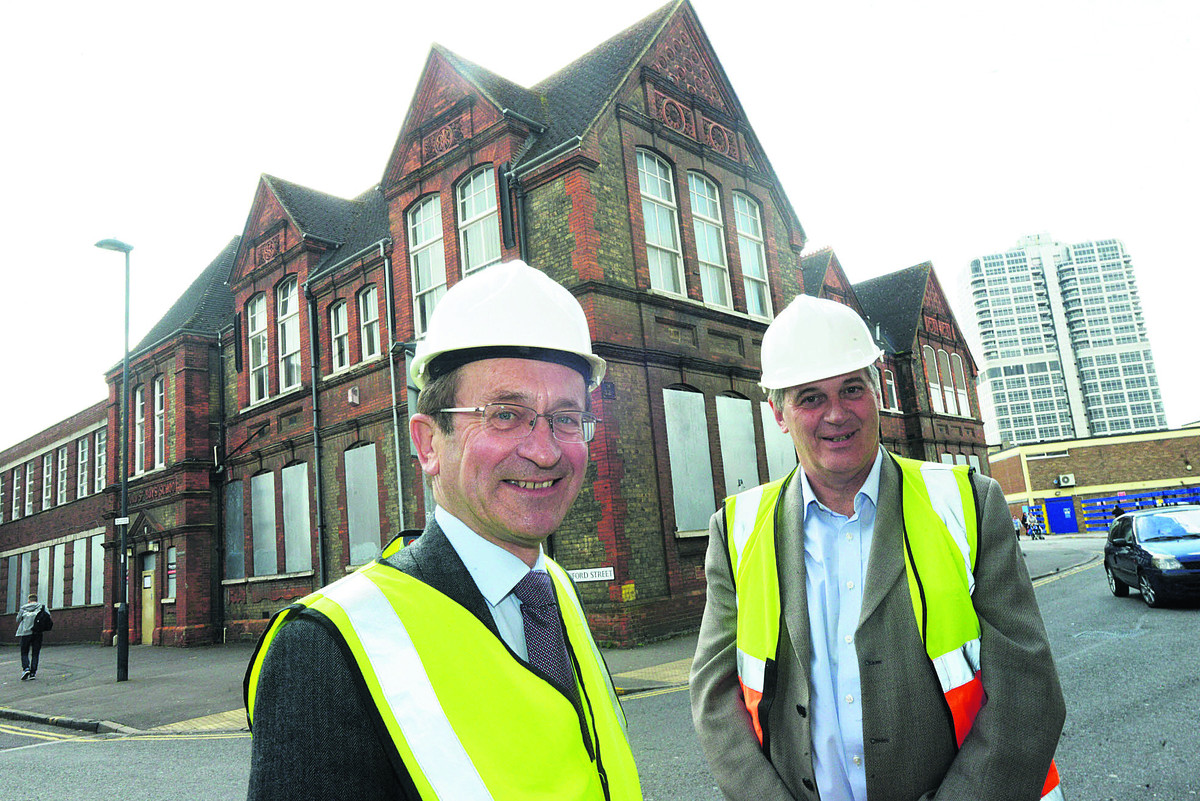 Brian Mattock and David Wray at Sandford House, where work is well under way for a summer opening
